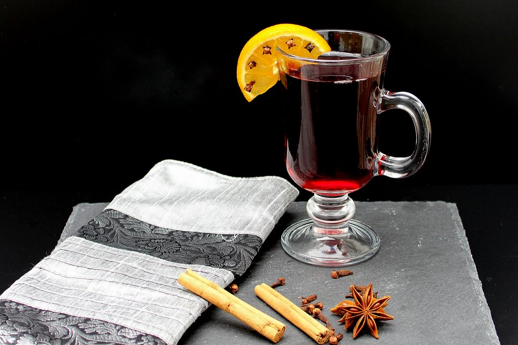 Handled glass with port and an orange slice studded with cloves