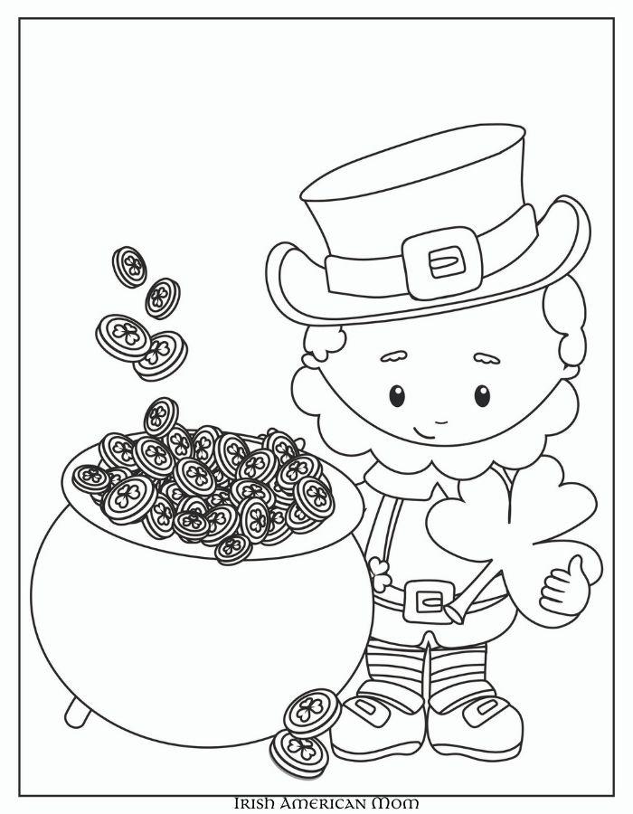 Leprechaun beside a pot of gold and holding a shamrock
