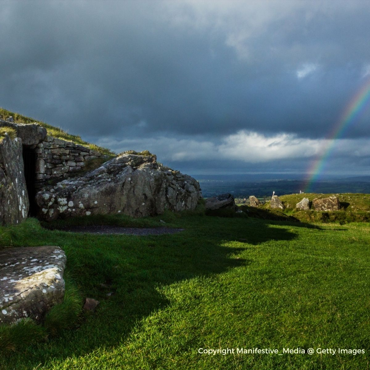 A rainbow beside an ancient passage tomb