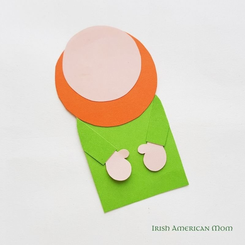 A paper cut out shaped like a leprechaun without a hat