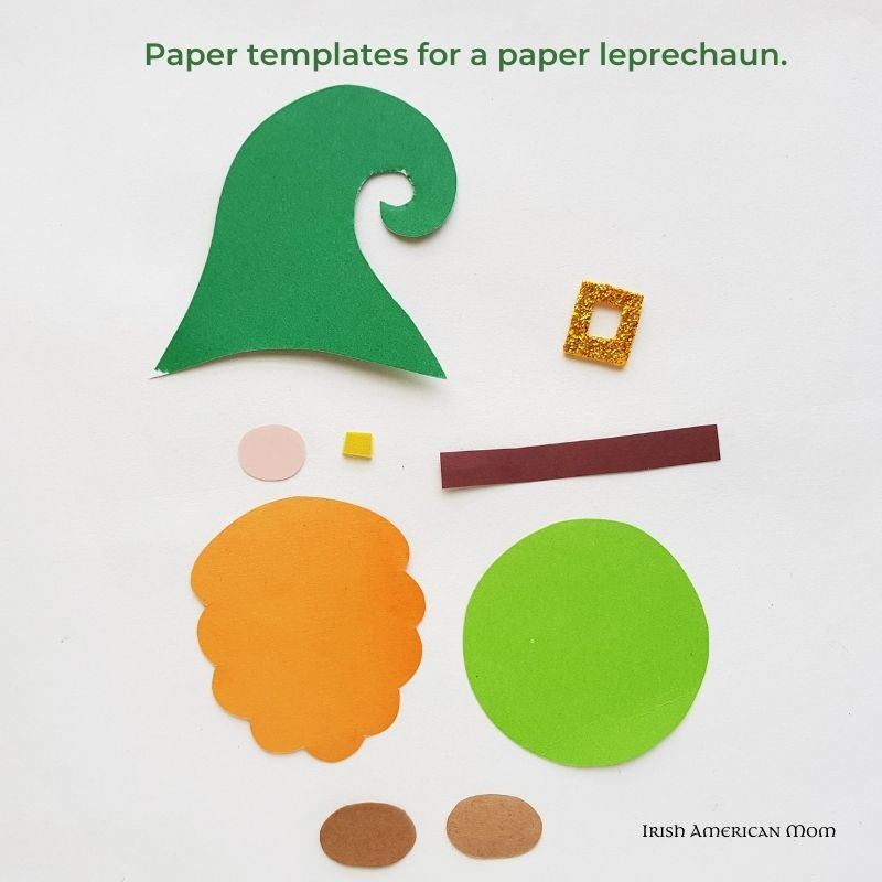 Paper template pieces cut out for making a paper leprechaun