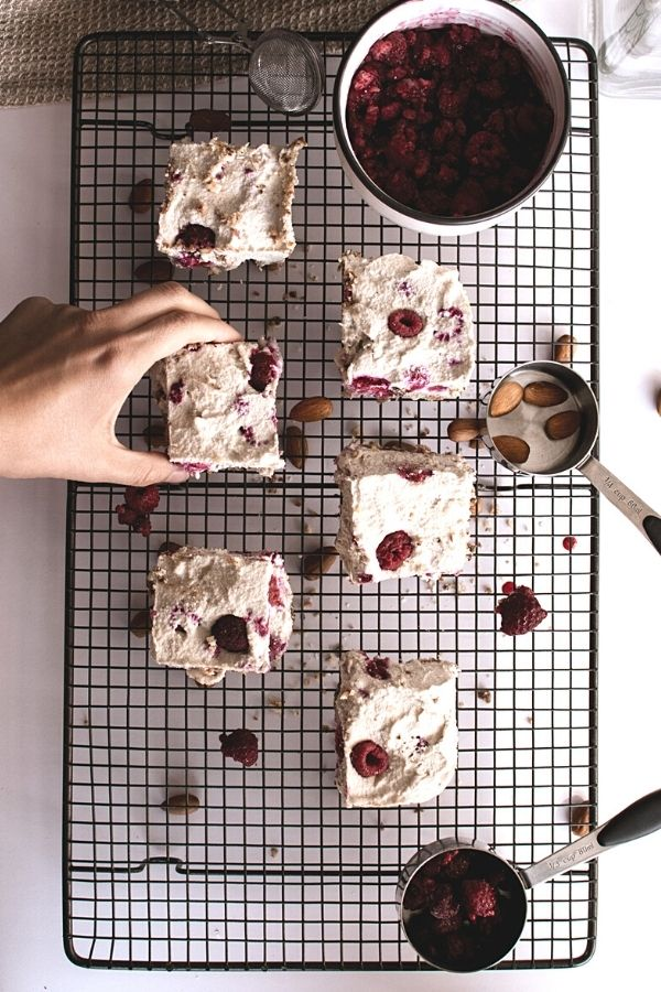Slices of raspberry cheesecake on a baking rack