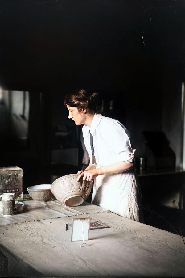 A woman baking using vintage ceramic bowls
