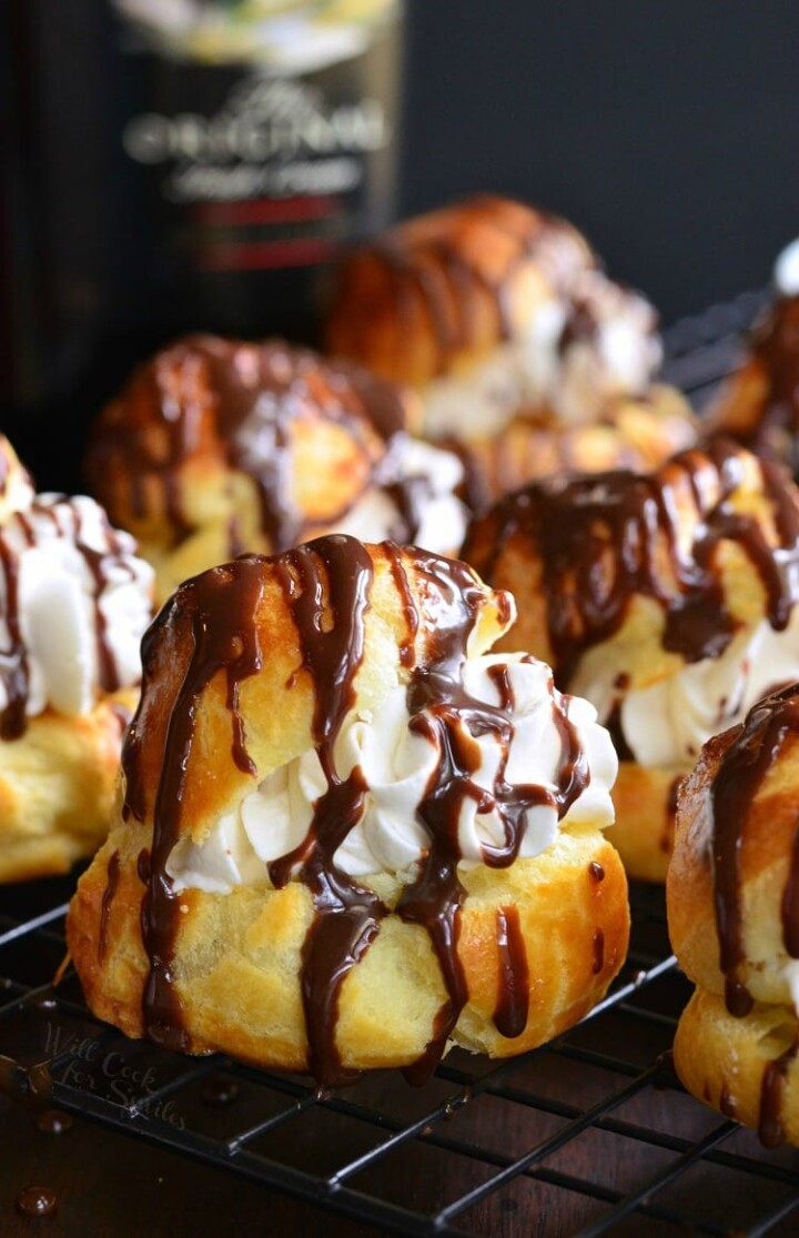 Cream puffs with chocolate drizzle topping