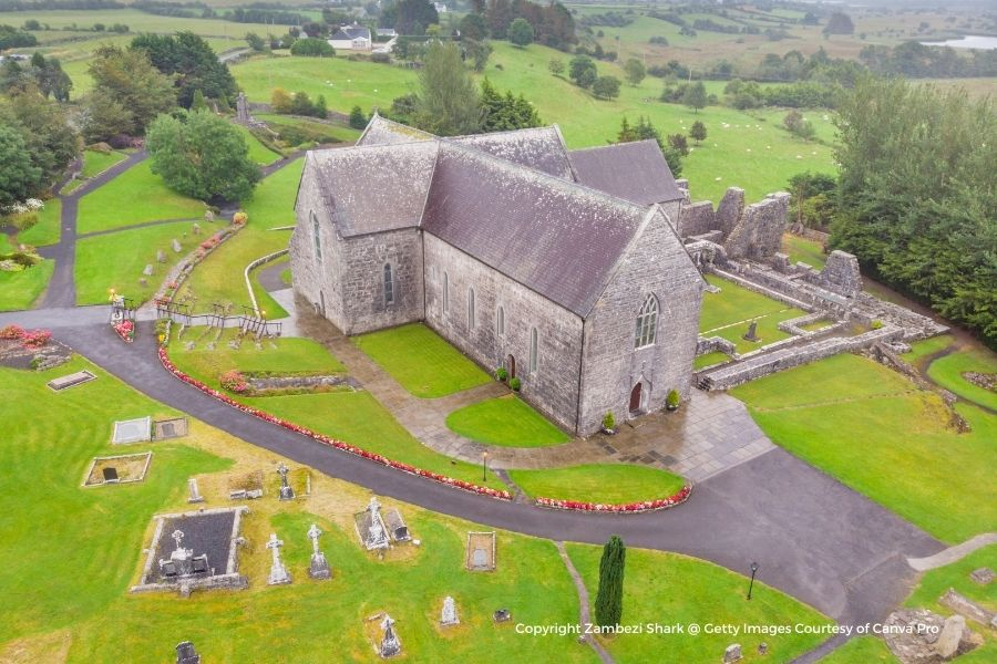 Aerial view of a stone building and graveyard