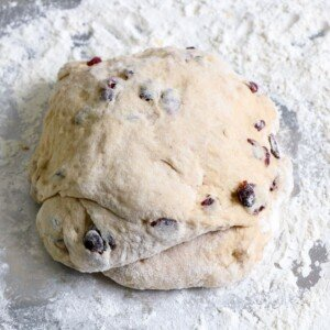 Hot cross bun dough turned out onto a floured surface