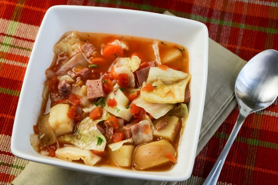 Cabbage and corned beef soup in a bowl