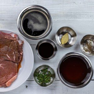 Steak and marinade ingredients in bowl as seen from above