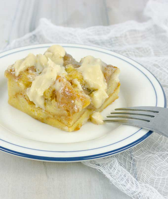 Serving of custard bread pudding with Irish cream on a plate