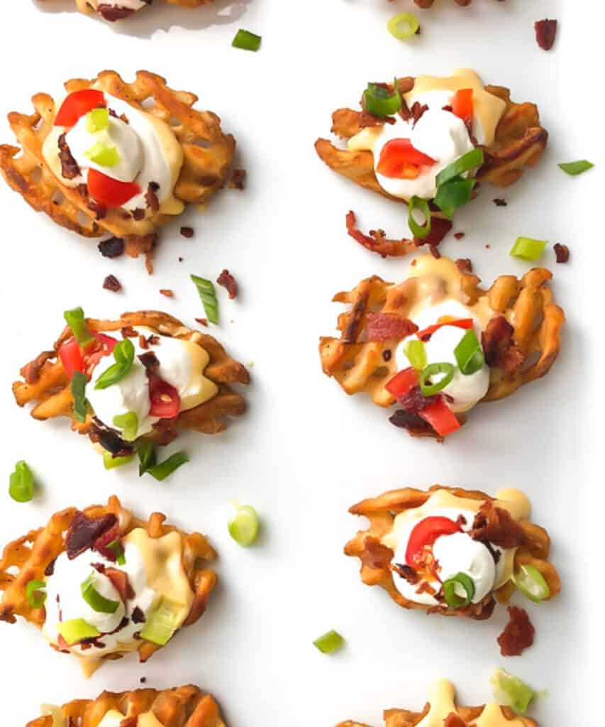 Waffle fries with sour cream and pepper toppings
