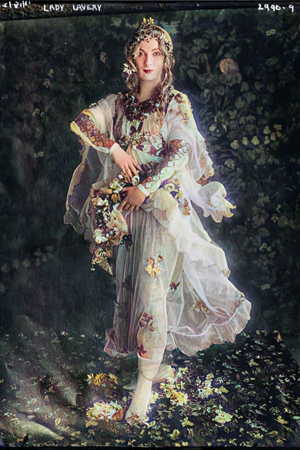 A woman in a sheer dress holding flowers