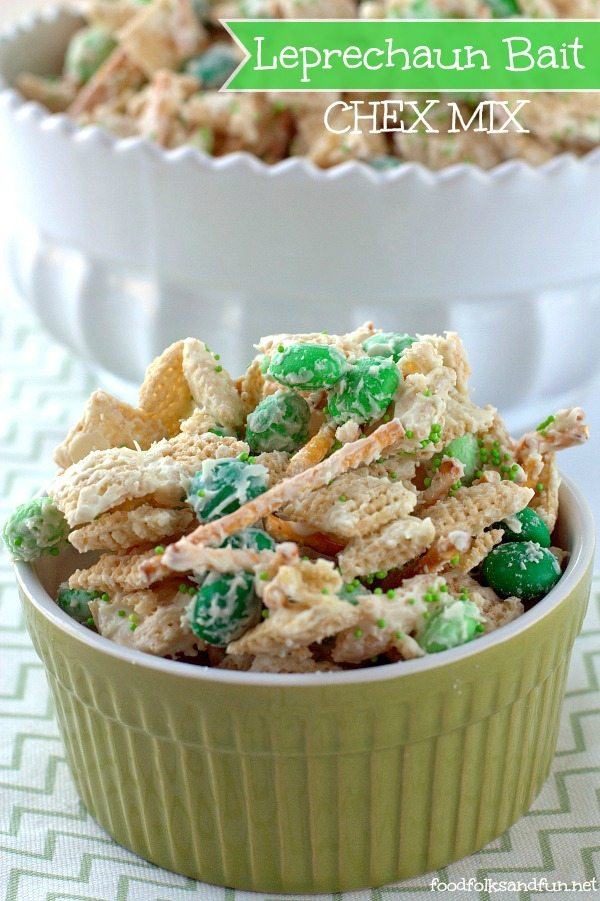 Chex mix with green candy in a ramekin