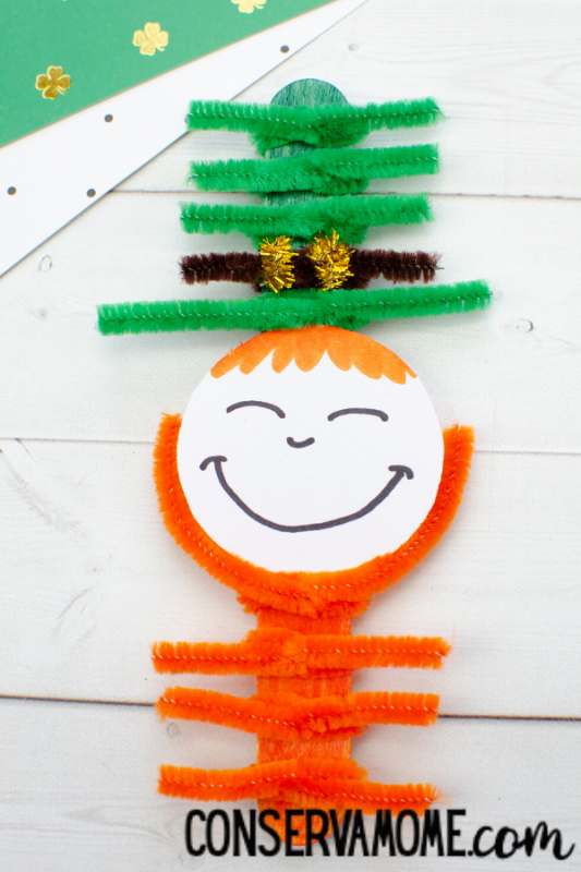 Pipe cleaner and popsicle stick leprechaun craft with text