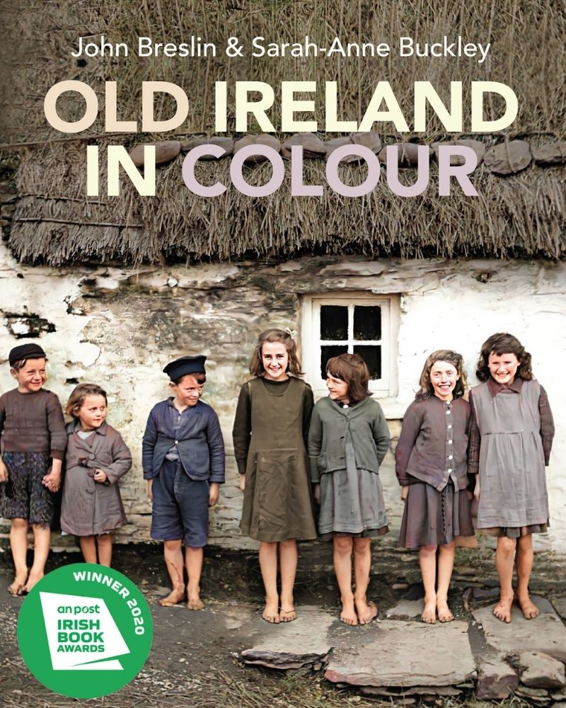 Book Cover with children standing outside a thatched cottage with text overlay