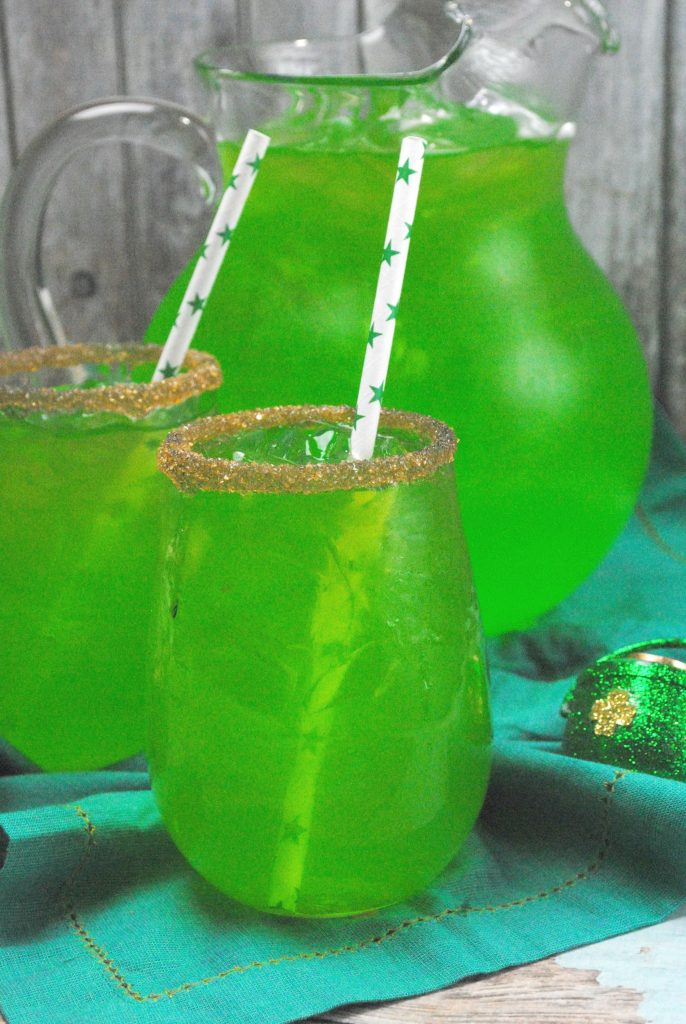 Green drinks in glasses with straws plus a pitcher of green liquid
