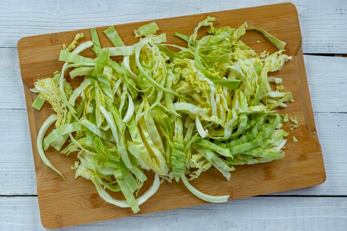 Shredded cabbage on a cutting board