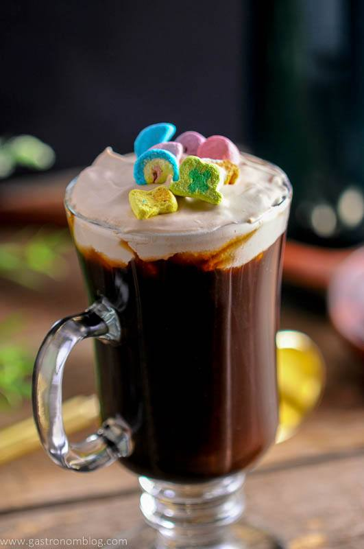 Irish coffee in a glass with a garnish of lucky chamrs