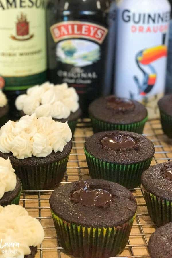 Chocolate cupcakes with ganache filling and a creamy topping
