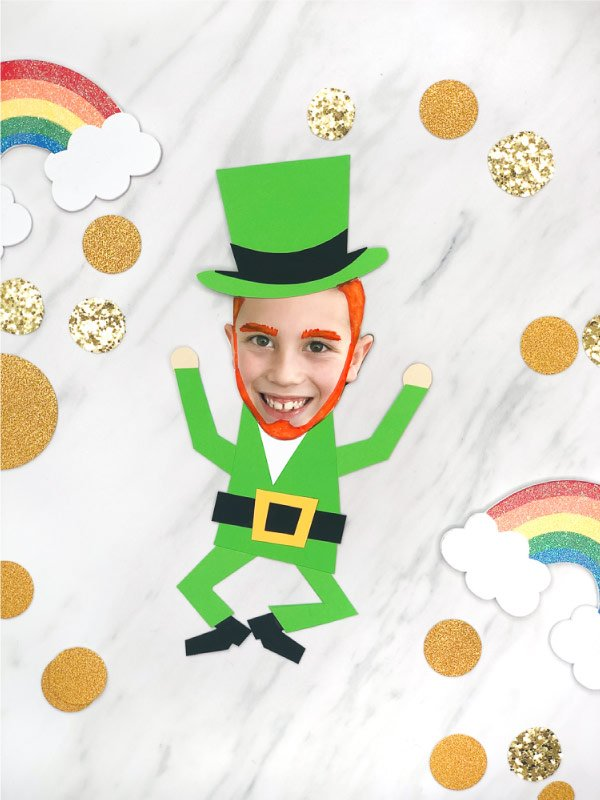 Paper leprechaun with a cut out photo face