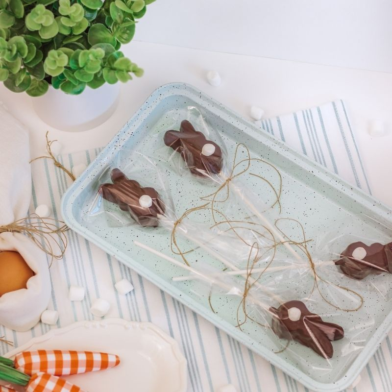 Wrapped chocolate rabbit gifts on a tray