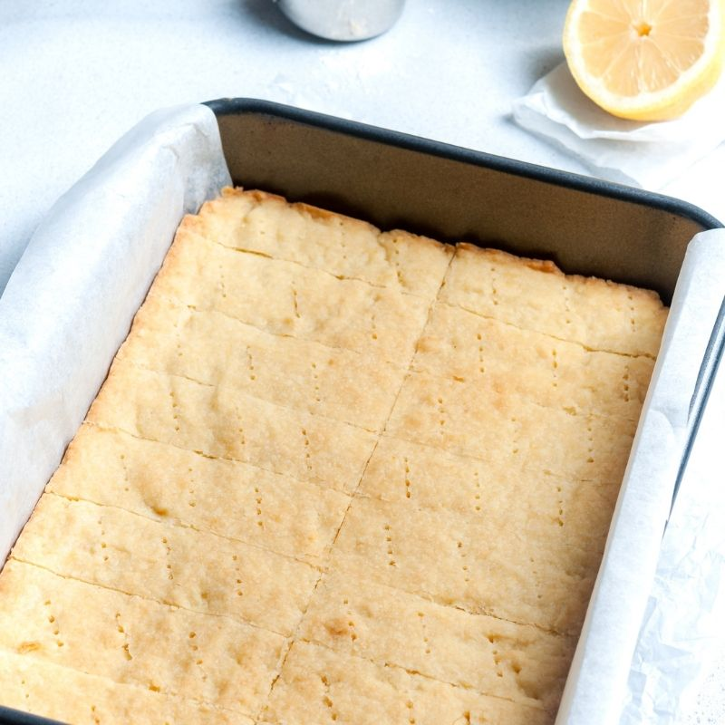 Shortbread in a baking pan marked with a fork