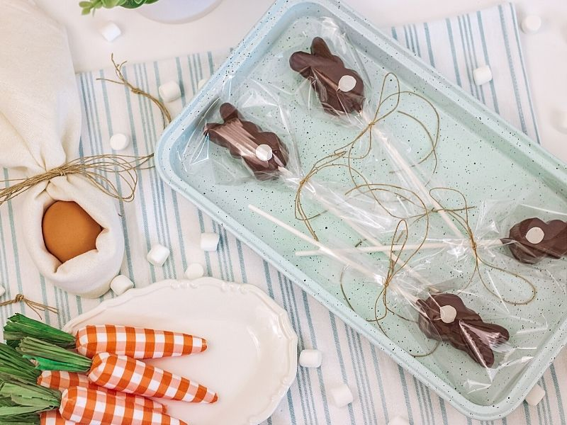 Plastic gift wrapping on chocolate bunnies on a plate