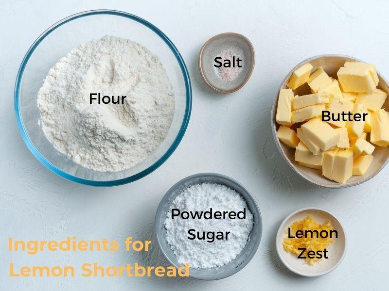 Bowls of flour, powdered sugar, butter, salt and lemon zest with text overlay