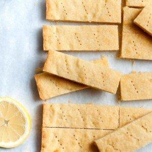 Slices of lemon shortbread beside a lemon half
