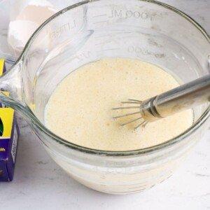 Eggs milk oil and vanilla in a bowl