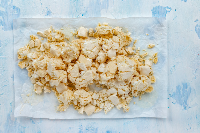 Crushed meringue pieces on a paper