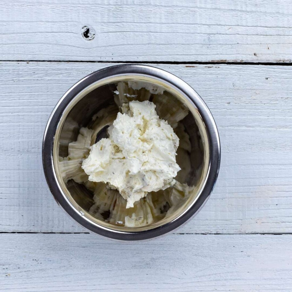 Cream cheese and horseradish mixed in a silver bowl