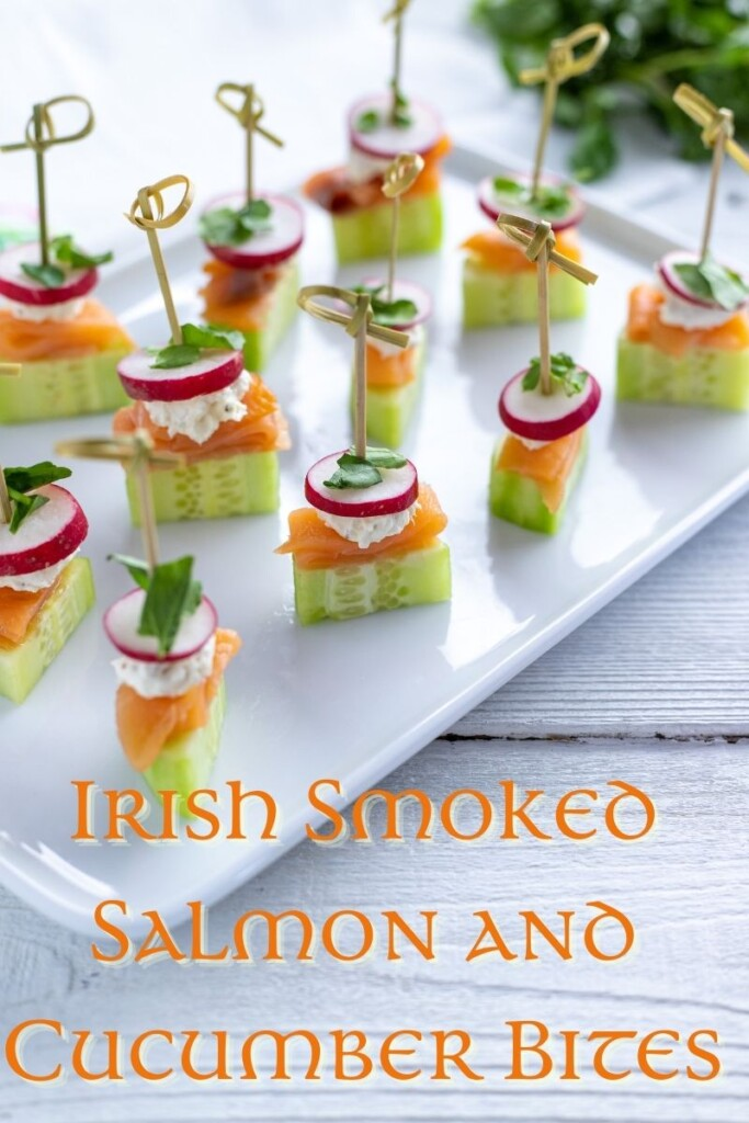 Text overlay on a tray of bite size salmon and cucumber appetizers