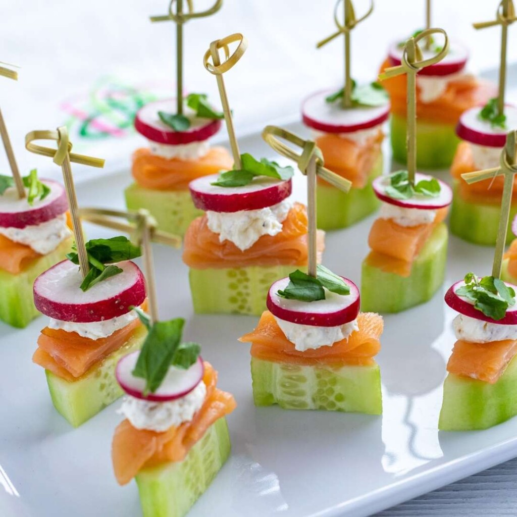 Cucumber, fish, cream cheese, radish and pea shoots helt together with appetizer sticks