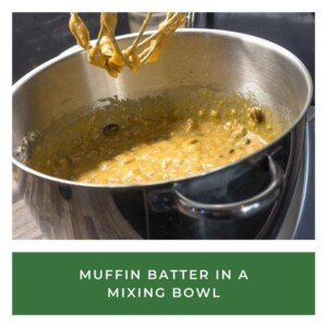 Batter in a mixing bowl beneath a beater with a text banner