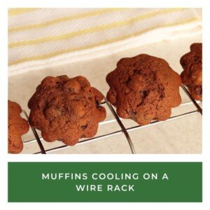 Muffins on a cooling rack over a text banner