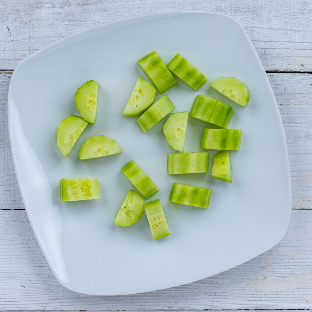 Sliced cucumber slices cut in half on a plate