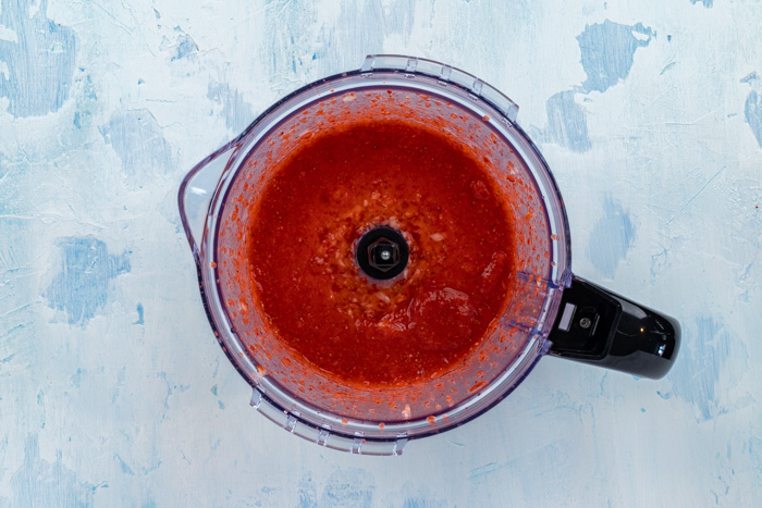 Strawberry sauce in a blender from an overhead perspective