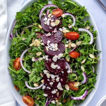Overhead shot of beetrood salad on a bed of greens