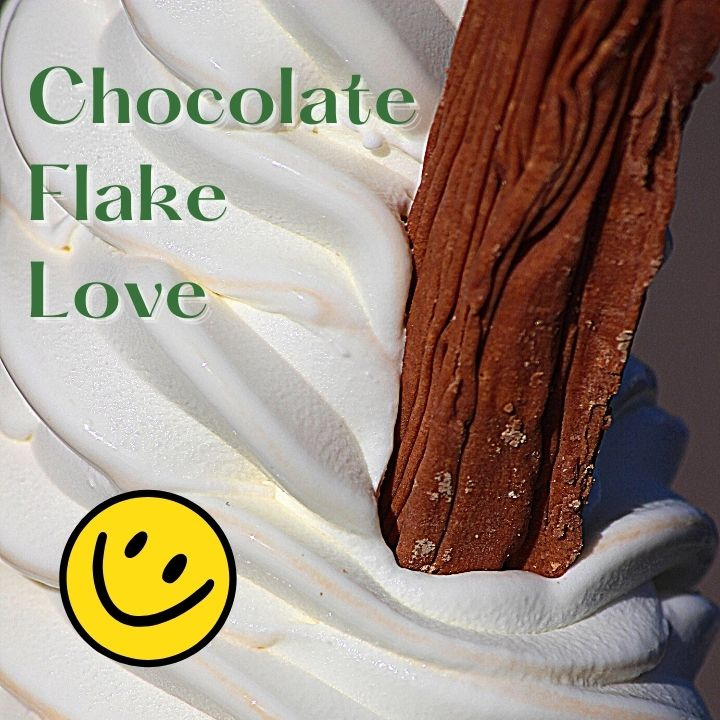 Flaky chocolate stick in ice cream with smiley face and text overlay