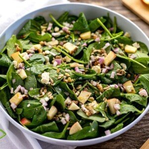Spinach and apple salad in a bowl
