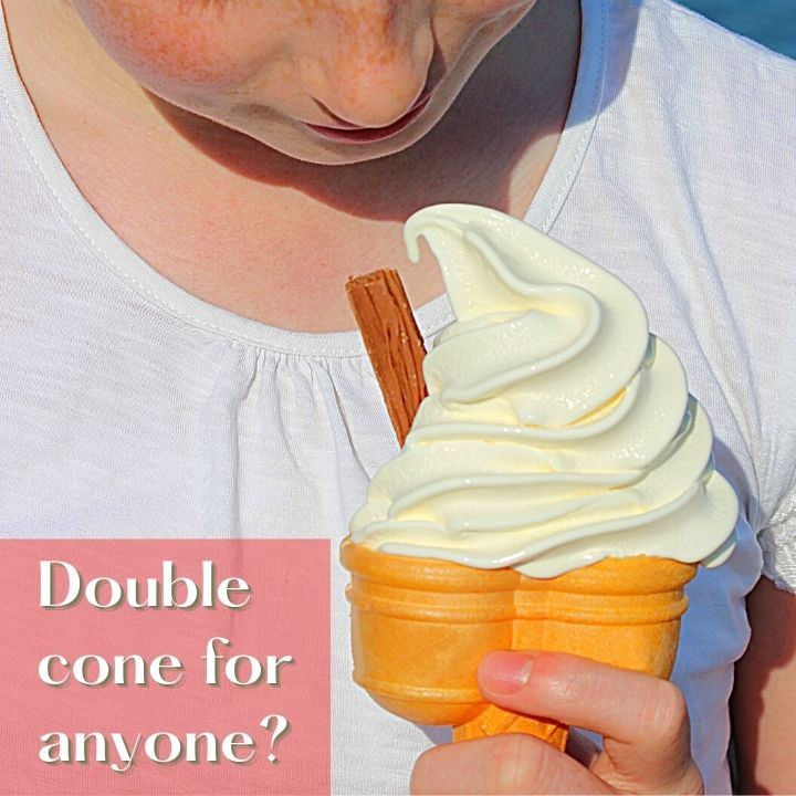 Double soft serve cone held by a girl with a text banner
