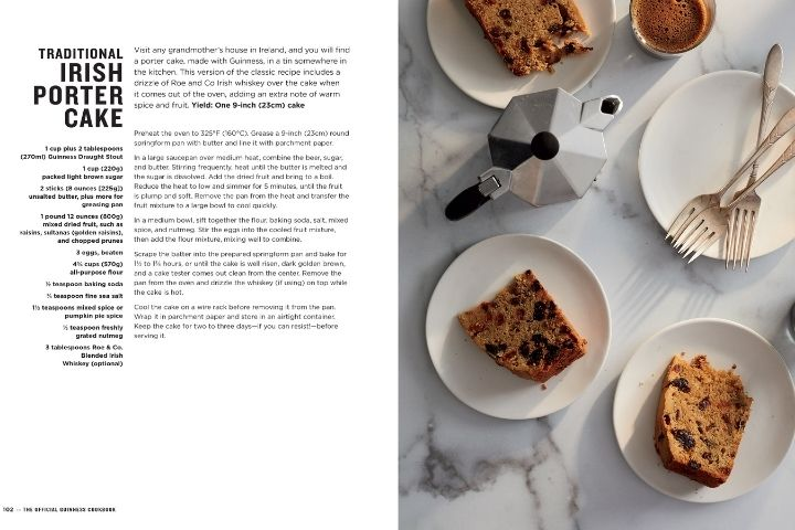 Slices of fruit cake on plates beside a text page