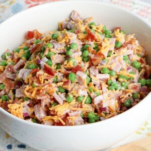 Pea and ham salad in a white bowl