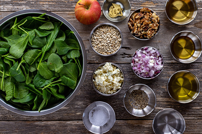 Looking down on bowls of salad and dressing ingredients