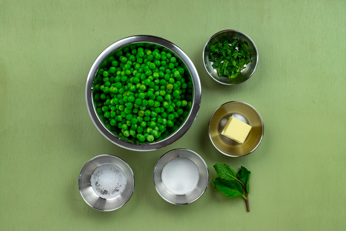 Bowls of peas, mint leaves, slat, sugar, and butter
