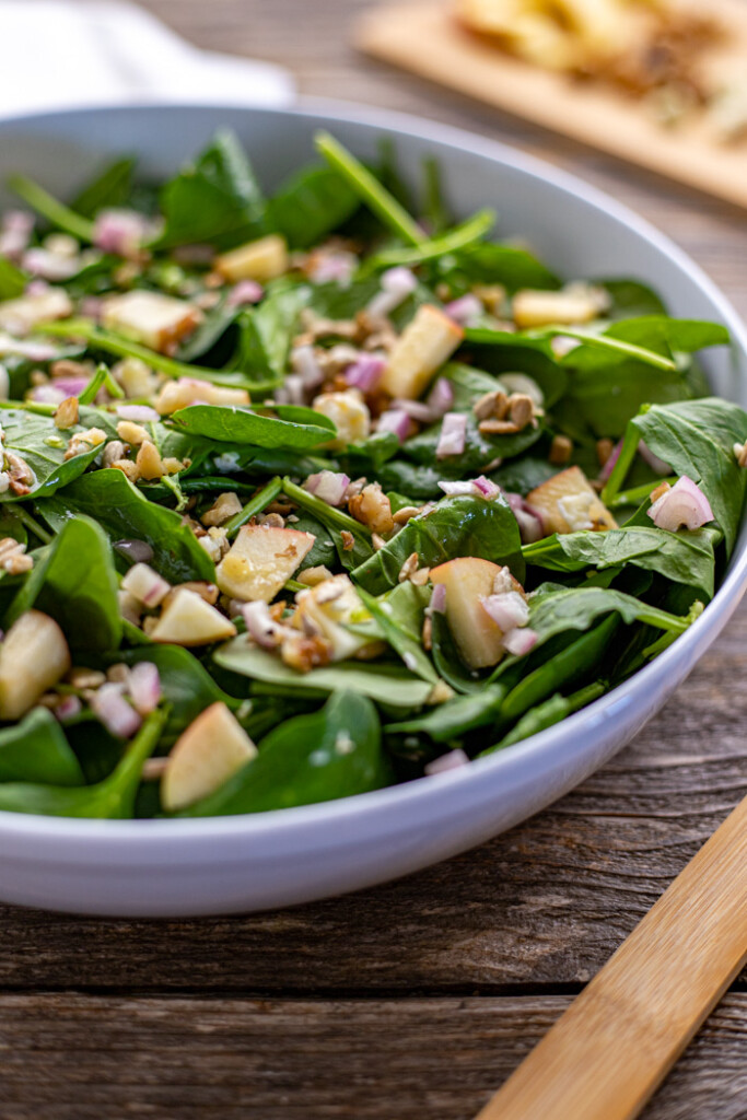 Spinach, apple, sunflower and blue cheese salad in a bowl