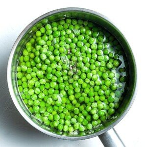 Peas and stock in a soup pot
