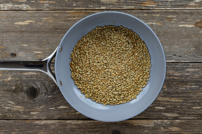 Overhead shot of sunflower seeds in a skillet