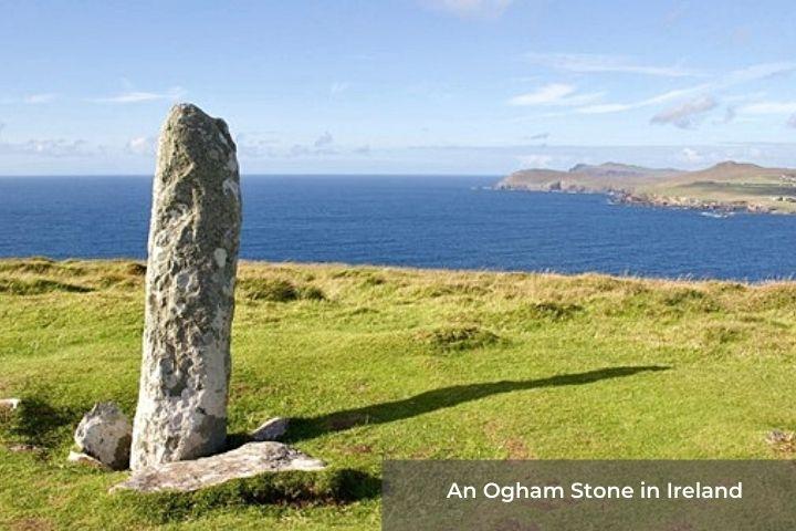A standing stone in a field beside the ocean
