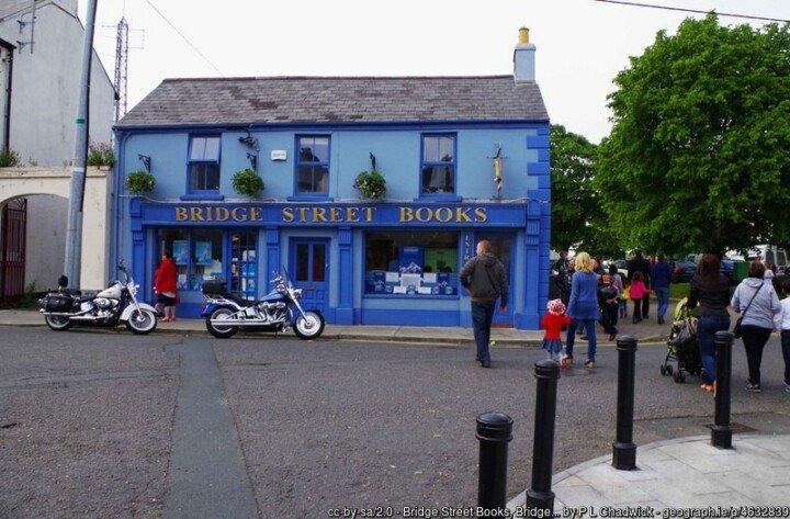 Blue book shop beside a street